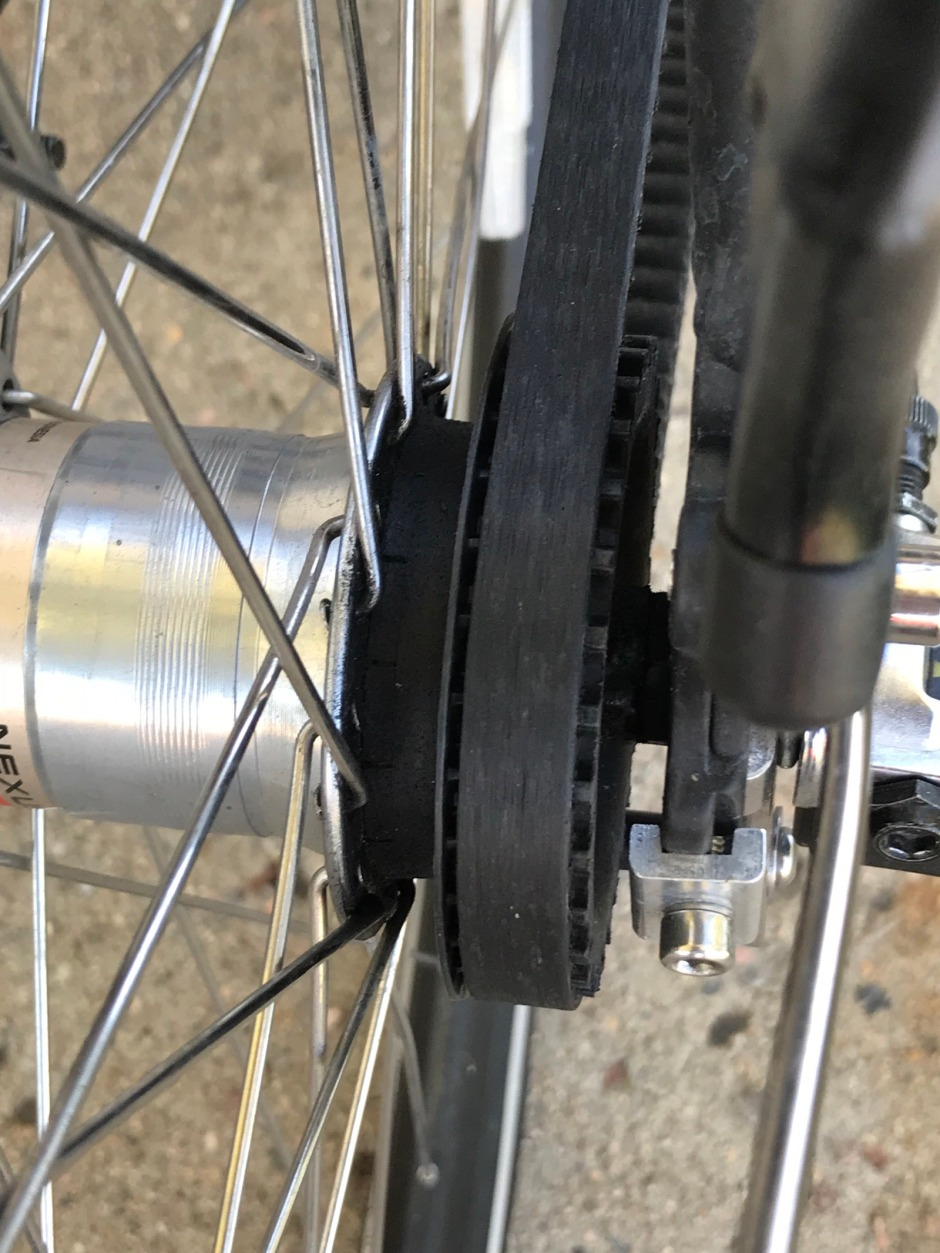 Example of the belt moving off the cog, away from the hub of the wheel.